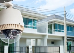 CCTV Camera or surveillance operating with house village in back